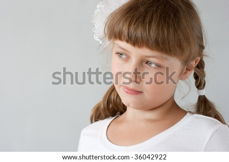 Cute preteen schoolgirl portrait near whiteboard - stock photo
