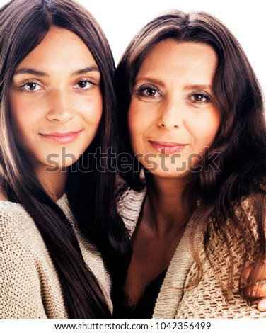 Stock Photo cute pretty teen daughter with real mature mother hugging, fashi