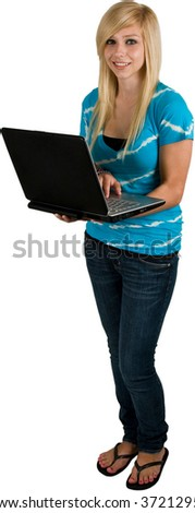 Cute Pretty Teenage Blond Girl With Laptop Computer