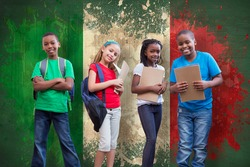 Cute pupils smiling at camera against italy flag in grunge effect