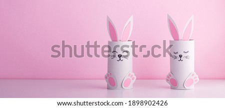 cute rabbits from a roll of toilet paper on a pink background.creative holiday background with handmade animals Foto stock ©