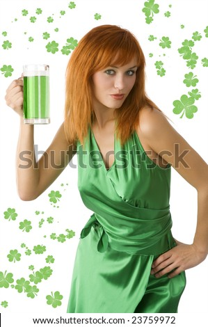 cute red haired woman posing in green dress and drinking green beer