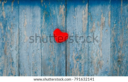 cute red heart knitted of yarn on the wall with old peeling blue paint #791632141