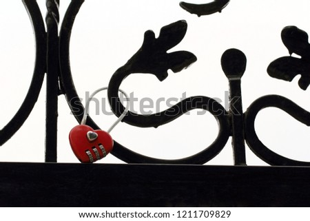 Cute red heart lock on iron black bridge with pattern. Combination padlock. Wedding background. White background #1211709829