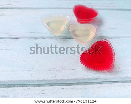 Cute red hearts and white made of jelly on blue wooden background, love is beautiful Valentine day #796131124
