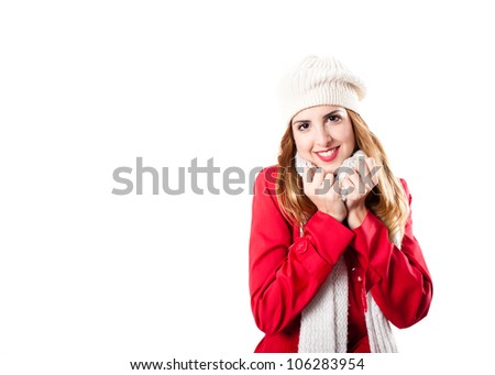Cute redhead looking at camera with white scarf and white hat