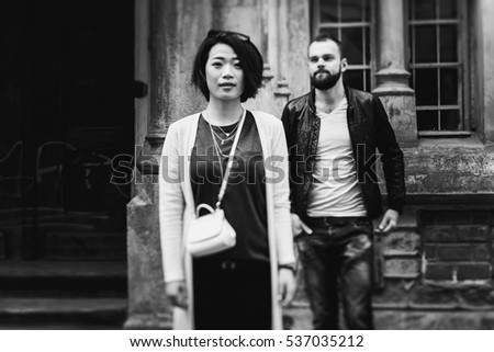 Cute Romantic Couple Posing Near Old European Theatre