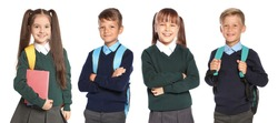 Cute school children in uniform with backpacks on white background