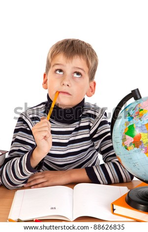 Cute schoolboy is thinking isolated on a white background