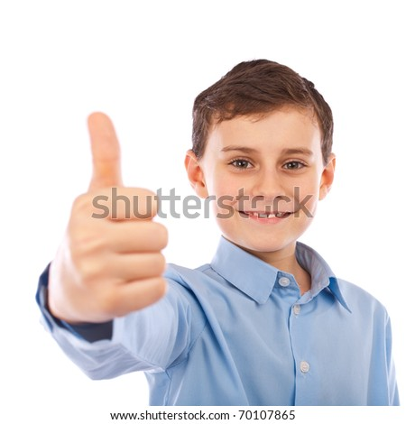 Cute schoolboy making thumbs up sign, isolated on white background