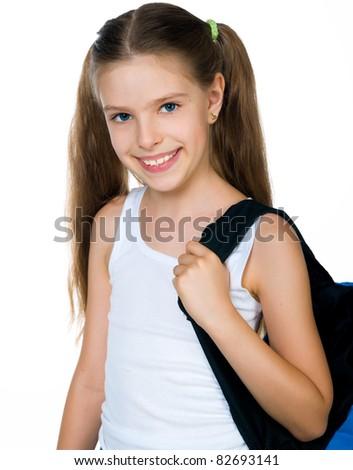 Cute schoolchild with knapsack on white background