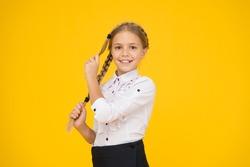 Cute schoolgirl with long hair. Graduation concept. Primary education. Perfect schoolgirl. Welcome back to school. Small schoolgirl with happy smile. Little schoolgirl looking nice in school uniform