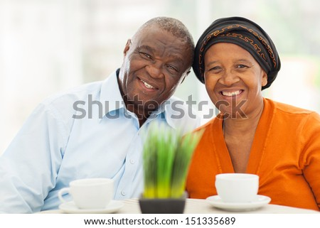cute senior african couple portrait at home