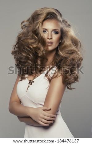 Cute sexy blond woman in studio