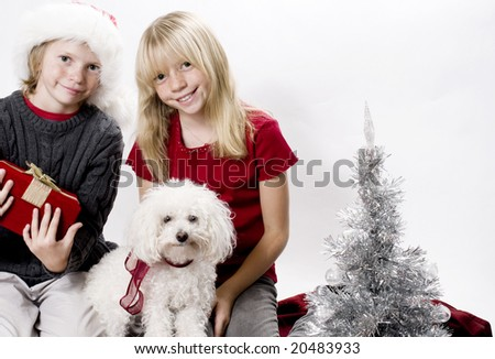 Cute Siblings and their Puppy Dog in the Christmas Spirit!
