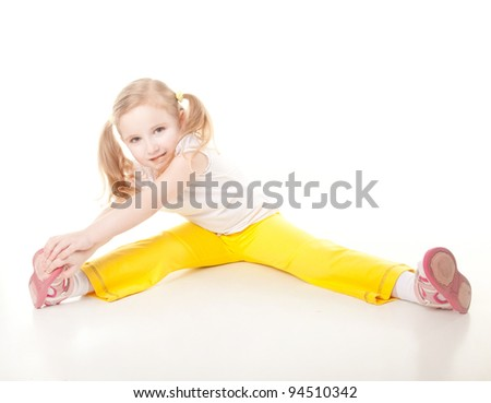 cute sly little girl doing gymnastic exercise