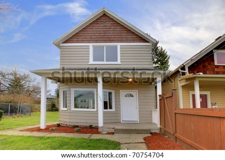 Cute small new beige house with covered front entrance