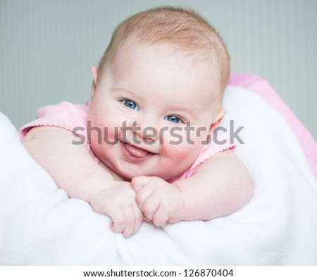 cute smiling baby  lye on a bed close-up