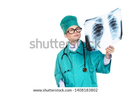 Cute smiling boy dressed like a doctor holding radiograph. Different occupations. Pediatrics. Isolated over white. #1408183802