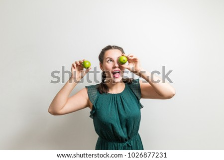 Stock Photo Cute smiling cheerful girl likes lime fruits and healthy food