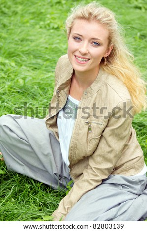cute smiling girl posing at the nature