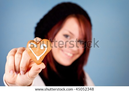 cute smiling girl with cookie in focus
