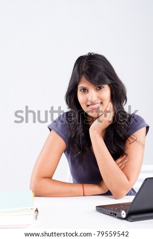 cute smiling indian female college student
