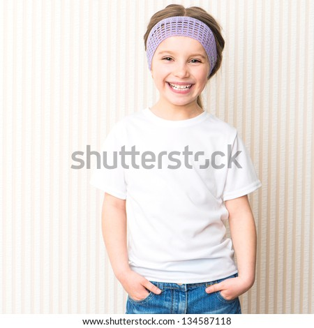 Cute smiling little girl in white t-shirt