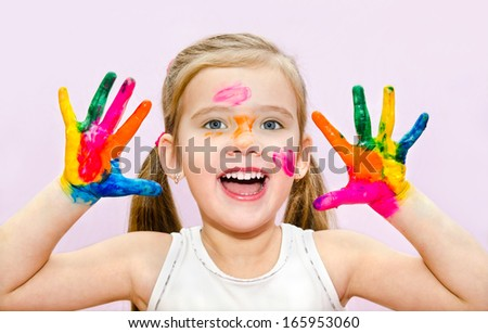 Cute smiling little girl with hands in paint isolated