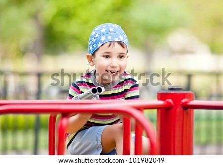 Cute smiling young boy with toy gun