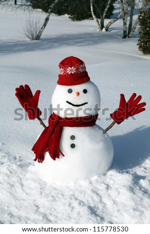 Stock Photo Cute snowman in his red outfit