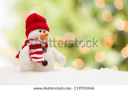 Cute Snowman Over Green and Gold Abstract Background.