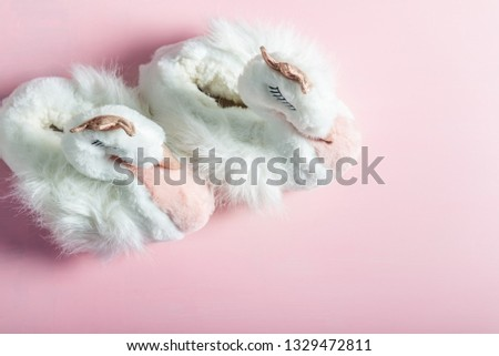 Cute soft 3d swan slippers, standing on the pink background #1329472811