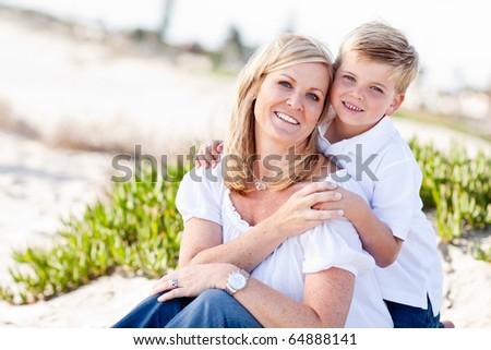 Cute Son Hugs His Attractive Mom Portrait at The Beach.
