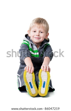 cute sportive boy workout sitting on floor isolated on white background