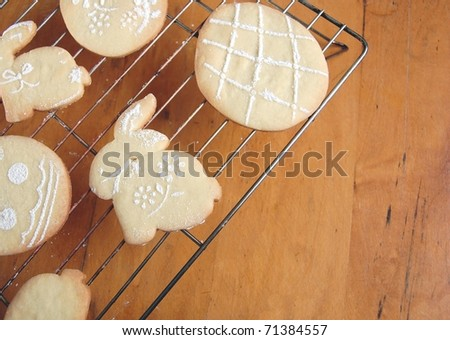 Cute, Sugar Powdered Easter Cookies Cooling on a Rack on a Wooden Table, with Room for Text