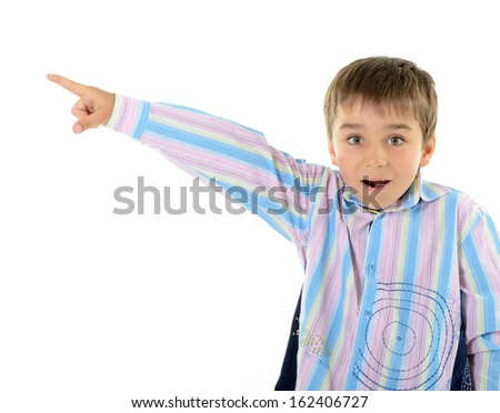 Cute surprise little boy pointing at copyspace, over white background