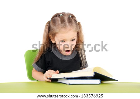 cute surprised little girl with the books