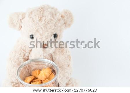 Cute teddy bear holding mini cookies vanilla tasty dessert  #1290776029