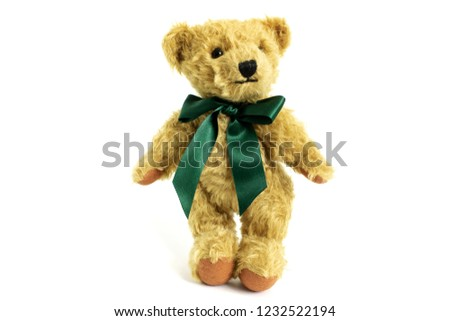 Cute teddy bear is standing, toy is made from golden mohair complemented with pure wool