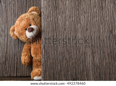 Cute teddy bear on old wood background with copy space - Shutterstock ID 492378460
