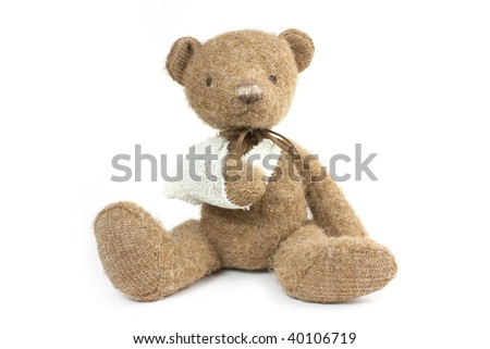 cute teddy bear with a broken arm in a sling