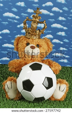 Cute teddy bear with a soccerball onb right background