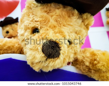 Cute teddy bear with heart on pink and white background, Sign of love #1015043746