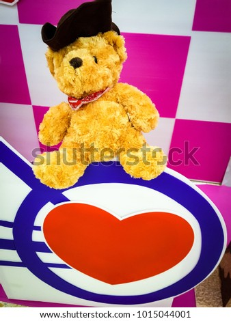 Cute teddy bear with heart on pink and white background, Sign of love #1015044001