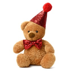 cute teddy brown bear in a red festive shiny cap and a bow tie around his neck. Toy isolated on white background
