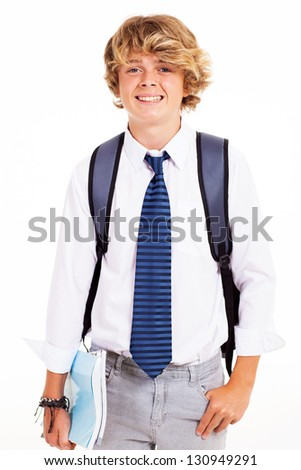 cute teen boy studio portrait with books and backpack - stock photo