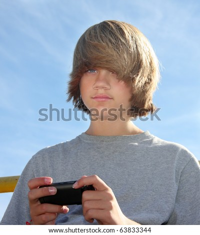 stock photo : Cute teen boy with cell phone, texting. Save to a lightbox ▼