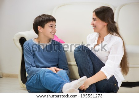 Cute teen boy with his young mother at home #195551273