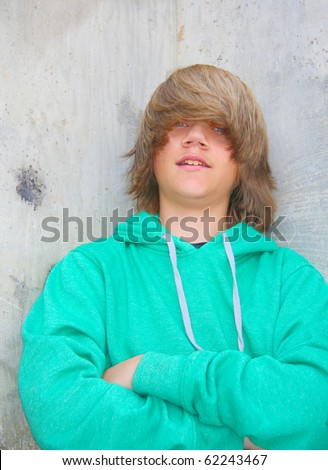 stock photo cute teen boy with shaggy blond hair and wearing a green sweatshirt standing against a cement wall 62243467 ILLEGAL ALIEN LATINA SEX WORKERS IN ILLEGAL ALIEN CAMPS IN SAN DIEGO COUNTY ...